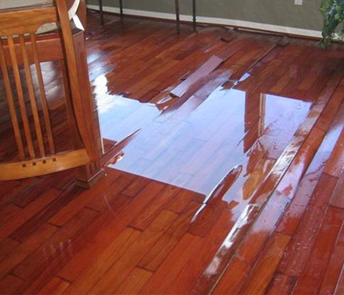 Houston Water Damage Warps Wood Flooring