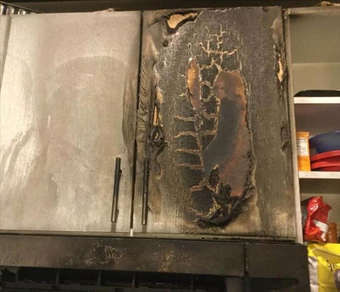 Fire damaged cabinet.