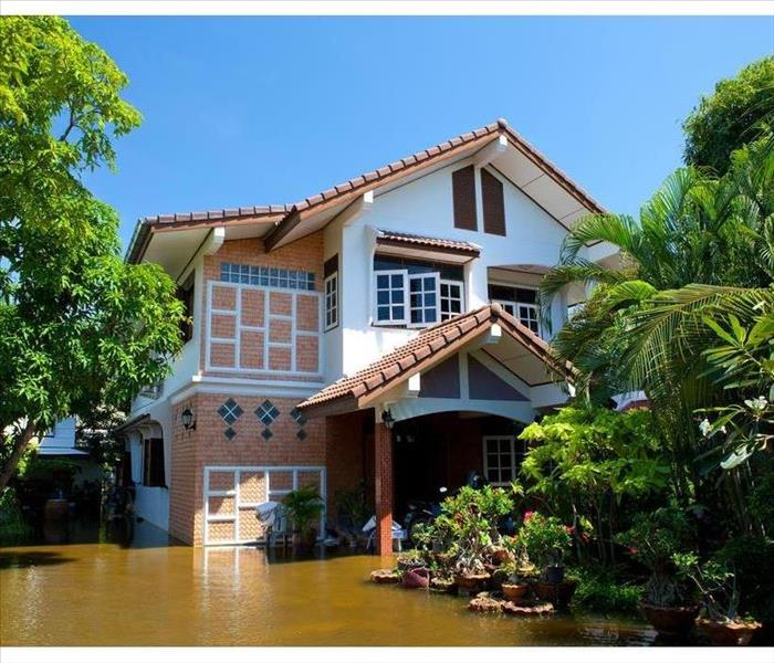 Flood waters in a house. Picture taken from the outside
