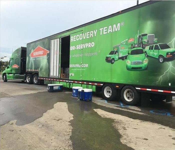 SERVPRO green semi truck, three coolers on the floor